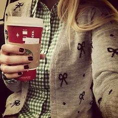 Bows cardigan, green gingham shirt, Starbucks. It's all good.