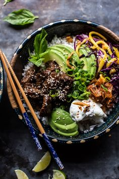 Korean Bulgogi BBQ Steak Bowls with white rice, shredded purple cabbage, thinly sliced mango, roasted broccoli, kimchi, sliced avocado, fresh basil, green onions and a poached egg- dressed in spicy peanut sauce  halfbakedharvest.com @hbharvest
