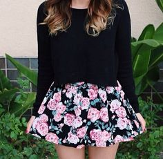 Black long sleeve shirt and pink floral skirt