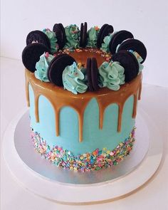 Turqouise drip cake with confetti & sprinkles topped with oreos