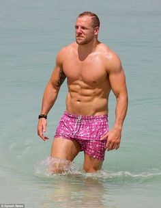 Buff: Stripping down to pink swimming trunks with white star prints, 30-year-old James happily exhibited his muscular figure in all its glory