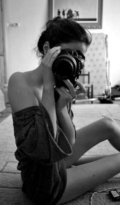Sexy woman and her camera