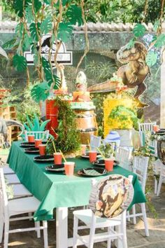Check out this cool Jurassic Park Dinosaur birthday party! Love the table settings! See more party ideas and share yours at CatchMyParty.com   #catchmyparty #partyideas #jurassicpark #dinosaurs #dinosaurparty #boybirthdayparty #tablesettings
