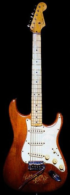 """Lenny"" A 1965 Fender Stratocaster Stevie Ray Vaughn found in a pawn shop in the early '80s but didn't have the $350 for. His wife Lenny and other friends bought the guitar for him. Original sunburst finish removed and brown stain applied. A butterfly tortoise-shell inlay in body, believed to be a 1910-era mandolin pickguard. It had a rosewood fretboard, later switched to maple neck that Billy Gibbons gave Stevie. It is reported that Stevie did the switch himself and used non-stock screws..."
