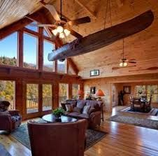 Wood columns are rarely a bad addition to a log cabin interior design. They can be installed in existing homes as purely decorative features and instantly add substance to an otherwise open room. Log Cabin Living, Log Cabin Homes, Cabin Interior Design, House Design, Interior Architecture, Blue Ridge Log Cabins, Mountain Cabins, Modular Log Cabin, Cabana