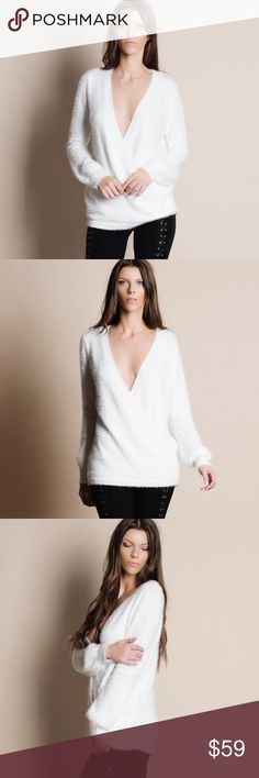 """Deep Plunge Faux Wrap Fuzzy Sweater Deep v neck faux wrap fuzzy sweater. Available in black and white. This listing is for the WHITE. Runs true to size, has some stretch. This is an ACTUAL PIC of the item - all photography done personally by me. Model is 5'10"""", 33""""-24""""-36"""" 32C wearing the size small. NO TRADES DO NOT BOTHER ASKING. PRICE FIRM. Bare Anthology Sweaters V-Necks"""