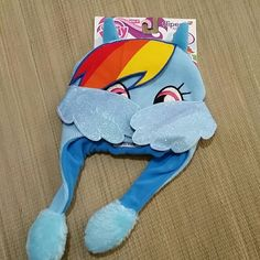 My Little Pony Flipeez Hat BNWT Girls 4+ My Little Pony Flipeez Hat BNWT Girls 4+ As seen on TV  Squeeze and wings flap! By ABG accessories  **No trades  **No off-site transactions  **Price ABSOLUTELY FIRM unless you bundle  **NO HOLDS. FIRST COME FIRST SERVED Accessories Hats
