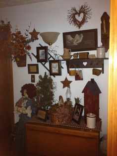 Primitive/country/rustic decor celebrating the love of my  babies.  pictures attached to a small ladder with berries along top.  And other pictures and saying to go with the theme.