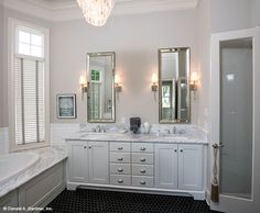 Dual vanities in The Monarch Manor home plan 5040. #WeDesignDreams
