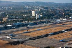 From across the airfield, Construction of the Terminal C concourse can be seen in the center off the picture.