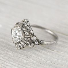 .97 Carat Art Deco Vintage Engagement Ring... this remarkable Art Deco vintage engagement ring is made in Platinum & centered with an old european cut diamond. Center diamond is accented by single & full cut diamonds set in a beautiful Art Deco setting with elegant millegrain edges & a delicate hand engraved band. Circa 1920.