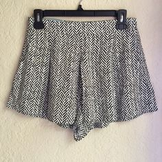 Black and White Patterned Short Beautiful patterned short. It has 2 pockets. Very soft and comfortable to wear. It looks like a skirt once you put it on. Shorts