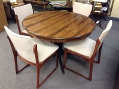 Rosewood Dining Table and 4 Chairs - Gorgeous rosewood round table with 4 rosewood chairs. The chairs have just been reupholstered . Set includes 2 leaves stored under the table top. Original Danish set from the early 70′s. Item 703-1. Price. $780.00 - http://takeitorleaveit.co/2015/02/12/rosewood-dining-table-and-4-chairs/
