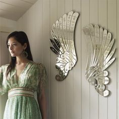 Angel wings Venetian mirrors from Graham & Green; her dress is gorgeous, too.
