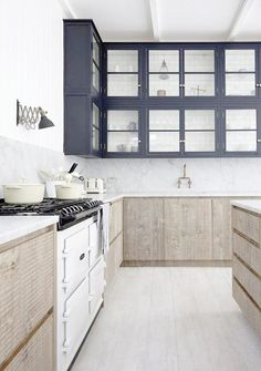 GET THE LOOK: TWO-TONED KITCHENS  We love this take on the two-toned cabinet trend right now!