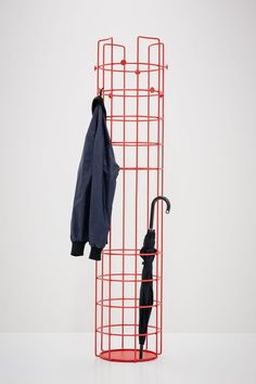 a red metal coat rack features several hooks for hanging and enough storage space for your umbrellas Shelf Furniture, Home Decor Furniture, Cool Furniture, Furniture Design, Free Standing Coat Rack, Regal Design, Modern Design, Coat Hanger, Coat Racks