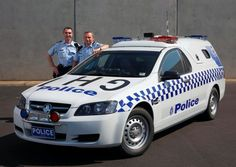Victoria (VIC) Police Holden Commodore ute with rear transporter shell.