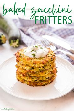 These Baked Zucchini Fritters are the perfect easy meal or snack made with fresh zucchini & cheese, and served with tzatziki - packed with flavour and a healthy choice!Recipe from thebusybaker.ca! #zucchini #bakedzucchinifritters #baked #veggie #vegetarian #fritters #easytomake #healthy #familymeal #snack