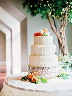 elegant buttercream wedding cake with fresh flowers