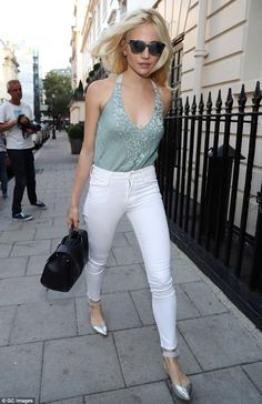 Pixie Lott struts her stuff in skinny jeans through the West End