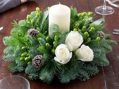 Christmas is coming soon so its time to start making some easy and fun Christmas decorations like these awesome table centerpieces christmas centerpieces Easy and Fun DIY Christmas Decorations and Table Centerpieces That Won't Break the Bank Christmas Flower Arrangements, Christmas Table Centerpieces, Christmas Flowers, Christmas Candles, Xmas Decorations, Simple Christmas, Floral Arrangements, Christmas Wreaths, Diy Christmas