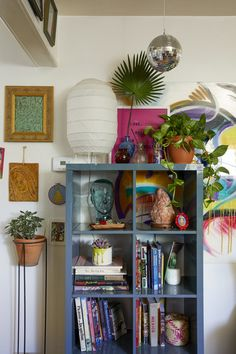 A mini disco ball hangs above a shelving unit with books, plants, and eclectic accessories. My New Room, My Room, Room Ideas Bedroom, Bedroom Decor, Indie Room, Pretty Room, Aesthetic Room Decor, Cool Rooms, House Rooms