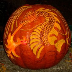Pumpkin carving of a dragon with fire.