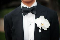 White orchid boutonniere - so clean and classic! Photo by Jennifer Bowen via JunebugWeddings.com
