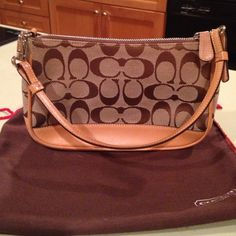COACH Mini Light Brown Tan Handbag Small handbag from Coach. There are some signs of use: some pilling on the top jacquard,  light water stains on the leather (bottom, back of tag, handle, edging). Nothing too obvious though, and the bag is still in good condition, perfectly usable. Comes with brown dust bag. Coach Bags Mini Bags