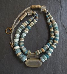 Exquisite colours in this double strand necklace of antique excavated glass trade beads from Djenne in central Mali, Africa. In its hey day Djenné being the oldest town in sub-Sahara, had been an important commercial and trading route but trade declined in the 20th century due to its