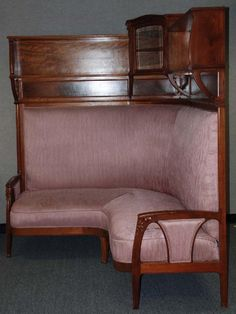 Majorelle art nouveau corner settee with bookshelve. Could do a lot with this