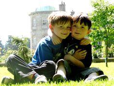 Cute kids at Powerscourt Gardens in County Wicklow, the garden of Ireland! Powerscourt House is in the background. www.powerscourt.ie