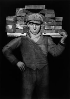 i like this photo from August Sander because it shows what it was like to work as a brick layer back in the early 20th century and this image shows you how serious the men were about their work back then.