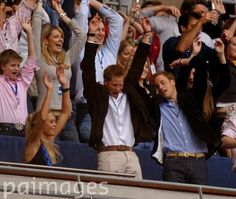 Britain's Prince Harry (centre) his girlfriend Chelsy Davy (left) and Prince William (right) during the charity concert in memory of Diana, Princess of Wales on what would have been her 46th birthday at Wembley Stadium, London.