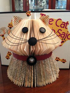 """I had Lillian Braun's book, """"The Cat Who Said Cheese"""", and because it only had 182 pages (or 91 foldable pages), I had to get creative. When I found the tutorial for folding a cat, I thought that would be perfect. I'm happy with the results. The tutorial is on my main board, """"Book Art Tutorials""""."""