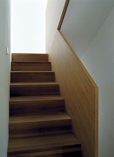Simple but beautiful and well made wooden staircase inside the Cube House by Plasma Studio.