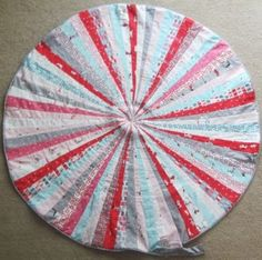 Amazing DIY Jelly Roll Floor Pillows