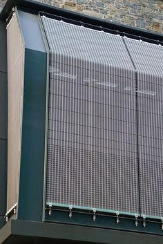 Specific geometry - Multidimensional form of the wire mesh façade cladding with 8° up to 19° deflected mesh elements. Media Façade Júlia Center, Andorra. Manufacturer: Haver & Boecker