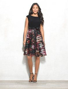 A stylish spin on classic stripes; this fit-and-flare dress is looking good in floral and black. Dress it up even more with your favorite sparkly earrings and go-to heels. Floral striped pattern on skirt. Imported.