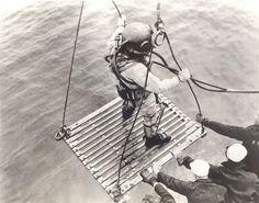 U.S. Navy salvage diver on platform.