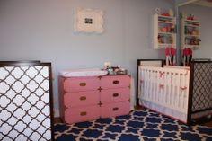 We love this vintage pink campaign dresser in this twin girls' nursery! #twins #nursery #vintage