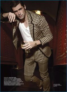 Sean O'Pry dons a houndstooth print suit from Gucci for GQ Style Mexico.