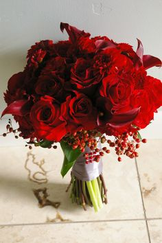 Red Christmas bouquet-I think this would still look great in a late November wedding!