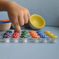 OMG, just realized these are painted door knobs! super cute sorting game for little hands.