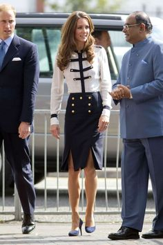 In an Alexander McQueen blouse and wool crepe skirt during a visit to Birmingham with Prince William.