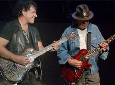 Neal Schon and Carlos Santana with PRS Signature Neal Schon Guitars Neal Schon, Music Articles, Steve Perry, Good Music, Rock N Roll, Journey, Singer, Rock Stars, Guitars