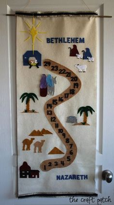 This Nativity Advent Calendar is made of felt and has a free pattern and tutorial. Mary and Joseph move up the path each day until they reach the stable on Christmas! #AdventCalendar #christmas #nativity