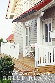 EXTERIOR COLORS:  Light stain on the deck. Light grey house. White trim. Red accent.
