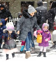 SJP and her twin girls Tabitha and Marion stylishly braved yesterday's blizzard in NYC.