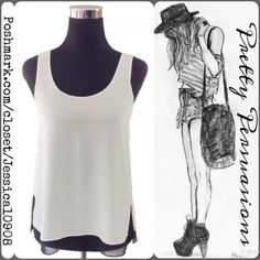 "VINCE Black & White Sleeveless Top MSRP $219.00  Measurements taken in inches: Length: 24.5"" Bust: 35"" Waist: 36"" Hips: 36"" Sleeveless  - black top with sheer white overlay & slits on each side of the top. Vince Tops Tank Tops"
